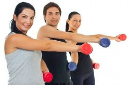 Fitness group lifting barbell