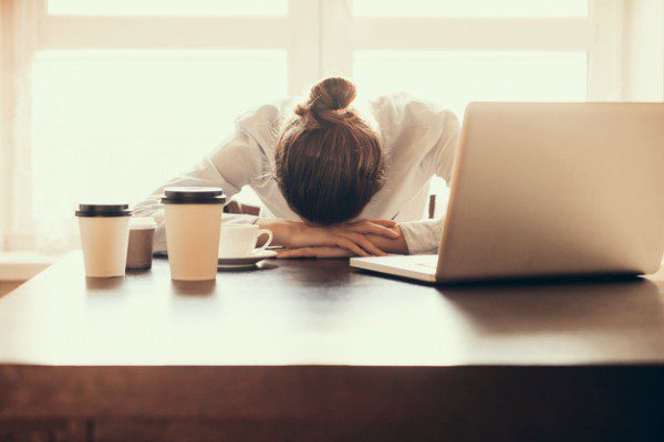 Depressed woman at work