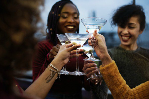 Female friends toasting martinis