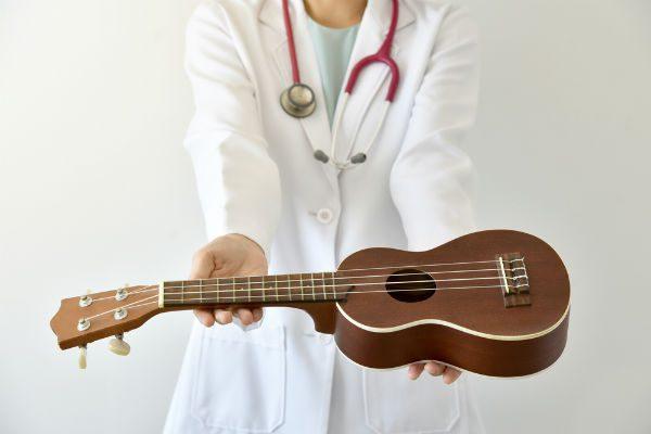 Nurse holding ukulele