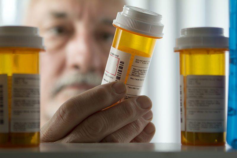 Man getting prescription pills