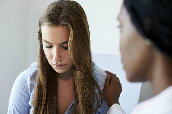 Teen girl with nurse