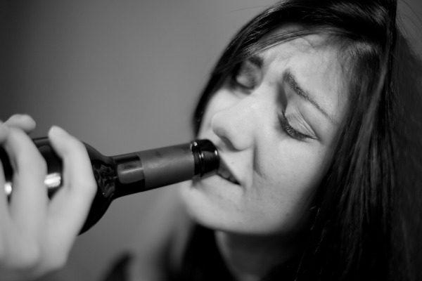 Woman getting drunk