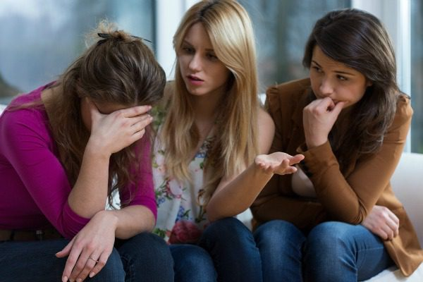 Women holding intervention for friend